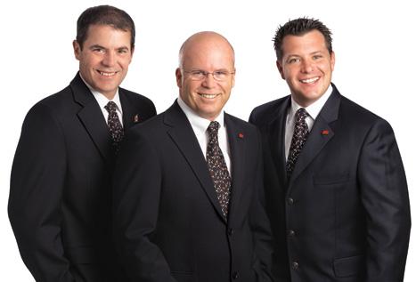 Luc Daigle, Robert Daigle et Charles Gingras, Épiciers-propriétaires.